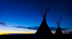two tipis at sunset